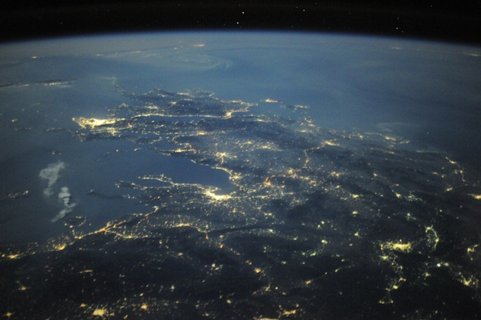 Greek islands on a clear night during our flight over Europe. Athens shine brightly along the Mediterranean Sea.