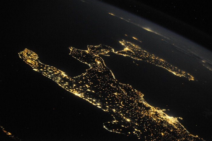 All the beauty of Italy, a clear summer night. You can see many beautiful islands that adorn the coast - Capri, Sicily and Malta. Naples and Mount Vesuvius are allocated along the coast.