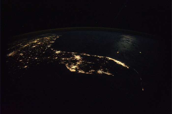 Florida and southeastern U.S. in the evening. A clear autumn evening, the moonlight over the water and sky, dotted with millions of stars.