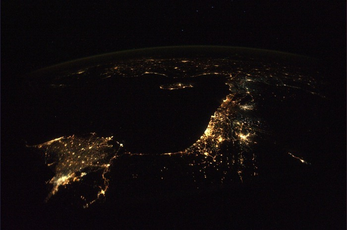 Clear starry night over the eastern Mediterranean. The ancient land with a thousand years of history stretching from Athens to Cairo. Historical land, the fabulous and alluring island: Athens - Crete - Rhodes - Izmir - Ankara - Cyprus - Damascus - Beirut - Haifa - Amman - Tel Aviv - Jerusalem - Cairo - all of them turned into tiny lights in this cool November night.