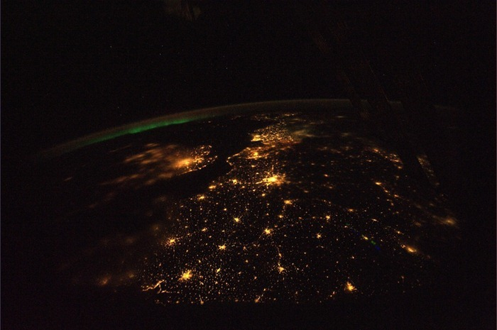 Northern lights in the distance in one of the finest nights over Europe. The photo clearly shows the Strait of Dover. Paris is dazzling with the city lights. A little fog over the western part of England can be seen, particularly over London.