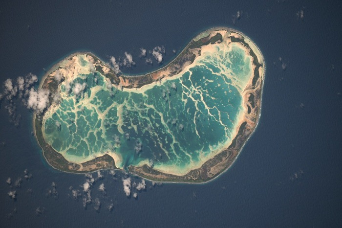 Beautiful atoll in the Pacific Ocean, photographed using 400mm lens. Approximately 1930 km south of Honolulu.